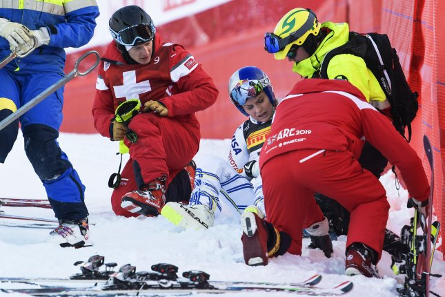 Lindsey Vonn (C) of the USA reacts after crashing during the women's Super G race at the FIS Alpine Skiing World Championships on Tuesday in Are, Sweden. Photo by Pontus Lundahl/EPA-EFE