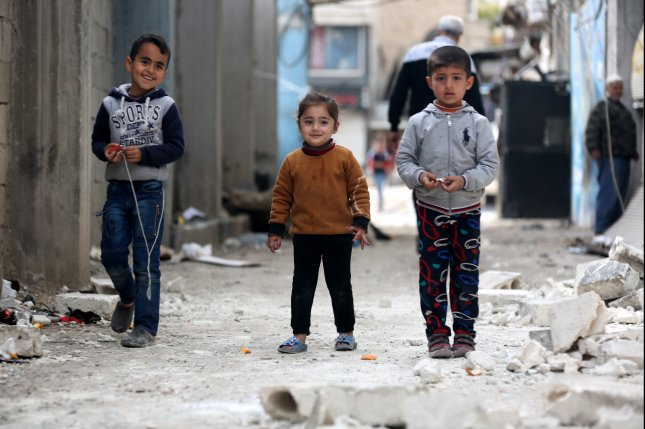 Syrian children play in Afrin, Syria. Russian and Syrian officials said Wednesday the United States should completely withdraw its forces from the country. File Photo by Aref Tammawi/EPA-EFE