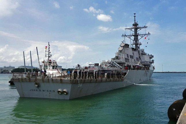 Guided-missile destroyer USS John S. McCain is moored pier side at Changi Naval Base, Republic of Singapore on August 21, 2017, following a collision with the merchant vessel Alnic MC while underway east of the Straits of Malacca and Singapore earlier that day. The ship now is undergoing repairs in Japan, where President Donald Trump visited. Photo courtesy /U.S. Navy