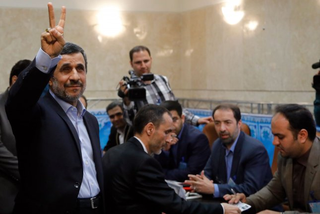 former iranian president mahmoud ahmadinejad flashes a victory sign after registering his candidacy for next months presidential election in tehran iran
