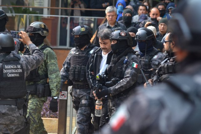 Damaso Lopez, the onetime heir apparent to Mexican drug lord Joaquin El Chapo Guzman, is escorted by security forces during his transfer in May 2017 to the Attorney's Office in Mexico City, Mexico. File Photo by EPA-EFE