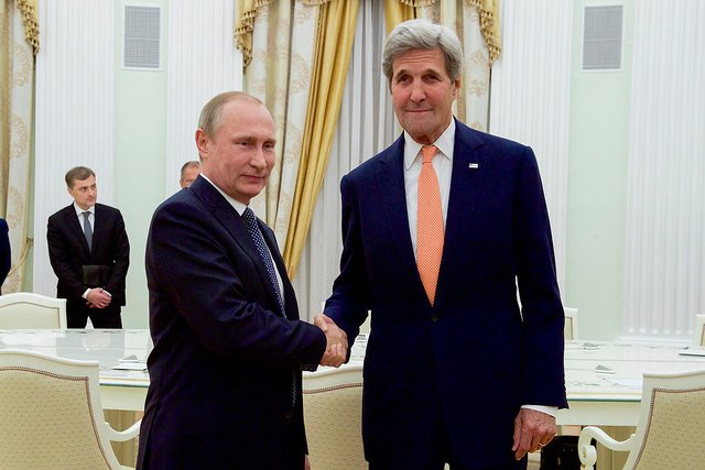 U.S. Secretary of State John Kerry shakes hands with Russian President Vladimir Putin in a meeting room at the Kremlin in Moscow, Russia, before a bilateral meeting on July 14, 2016. Photo courtesy of the U.S. State Department