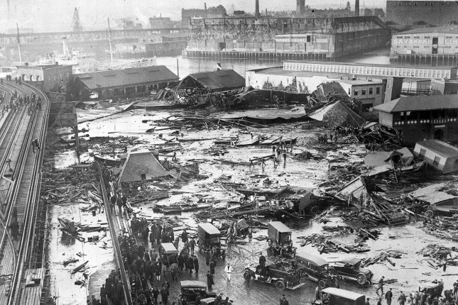 On Jan. 15 1919, 21 people were killed and scores injured when a vat holding 2.3 million gallons of molasses exploded and sent torrents of the syrup into the streets of Boston. The event is known as the Boston Molasses Disaster. File Photo courtesy of the Globe Newspaper Co.
