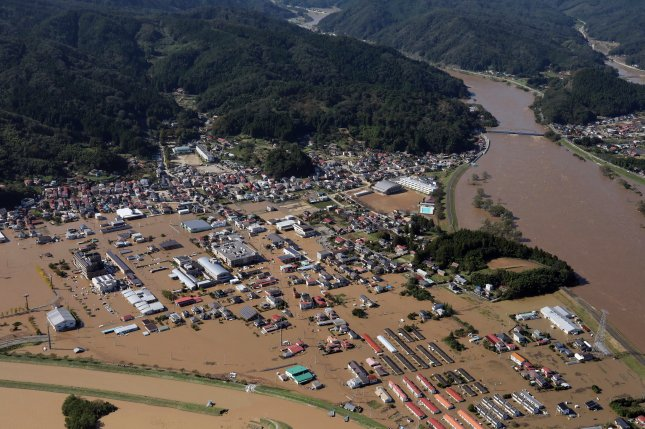 Floodwaters and landslide debris is seen Sunday in Marumori, Miyagi prefecture, Japan, following Typhoon Hagibis. Photo by Jiji Press/EPA-EFE