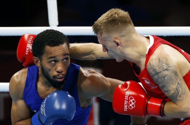 Duke Ragan of the United States (L) on Tuesday advanced to the men's featherweight (52-57kg) gold medal bout. Photo by Rungrou Yongrit/EPA-EFE