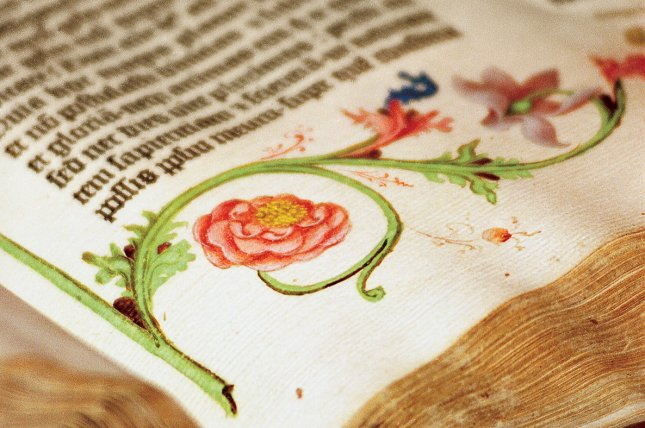 Vivid reds, pinks and greens of the illustrations run alongside the text in the Gutenberg Bible, the first printed Bible, which was produced in Mainz, Germany, in 1455. William H. Scheide donated $300 million worth of rare books and manuscripts, including this Bible, to Princeton University. Photo by Natasha D'Schommer