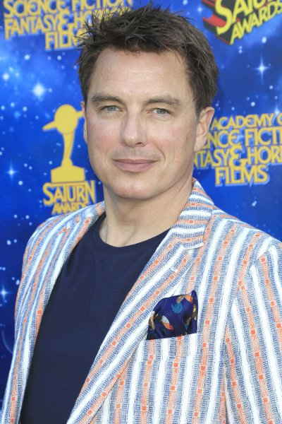 U.S. actor and host John Barrowman poses for photos at the 42nd Annual Saturn Awards held at The Castaway in Burbank, Calif., on June 22, 2016. The actor said he would love to return to Arrow, even though his character appears to have been killed off. File Photo by Nina Prommer/EPA