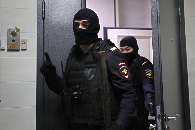 Police officers leave the flat of opposition leader Alexei Navalny in Moscow, Russia, on Wednesday. Photo by Yuri Kochetkov/EPA-EFE