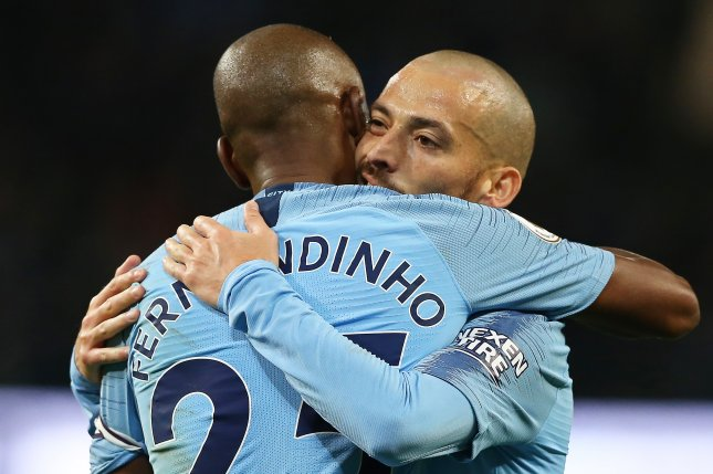 Manchester City players Fernandinho (L) and David Silva (R) celebrate during the English Premier League soccer match between Manchester City and Manchester United on Sunday in Manchester, Britain. Photo by Nigel Roddis/EPA-EFE