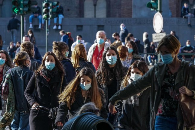 People wear face masks at Castello Square in Turin, Italy, on Sunday. Italy's government has made it mandatory to wear face masks outdoors in an attempt to counter the spread of coronavirus. Photo by Tino Romano//EPA-EFE