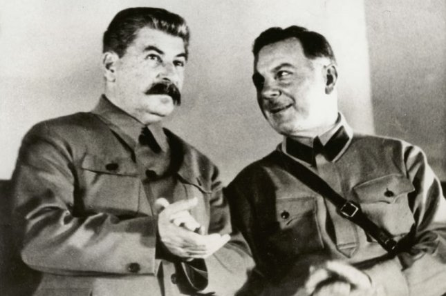 Josef Stalin, dictator of Russia (L) with Minister of War Kliment Voroshilov on the presidium of the conference of men and women Stakhanovite workers in the Grand Hall of the Kremlin Palace in Moscow, December 1935. File Photo by International News Photos/UPI