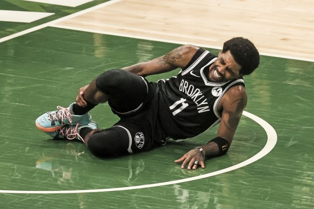 Brooklyn Nets guard Kyrie Irving injured his ankle during the second quarter of the Nets' Game 4 loss to the Milwaukee Bucks on Sunday at Fiserv Forum in Milwaukee. Photo by Tannen Maury/EPA-EFE