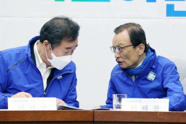 Lee Hae-chan (R), leader of South Korea's ruling Democratic Party, condemned politicians who distort history, in reference to the 1980 Gwangju Uprising. File Photo by Yonhap/EPA-EFE
