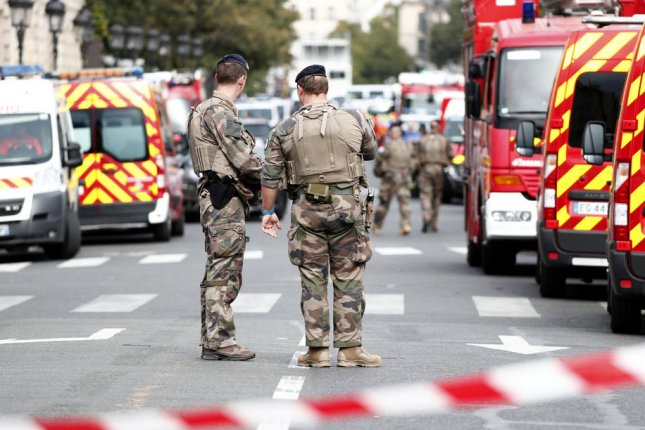 Military forces establish a security perimeter near police headquarters in Paris on Thursday, after an attacker killed four officers. Photo by Ian Langsdon/EPA-EFE