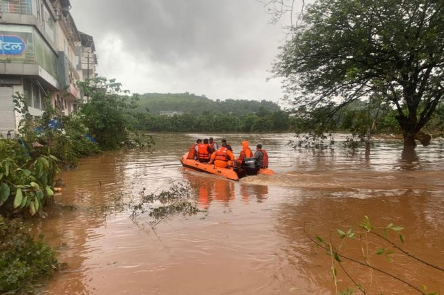 Personnel are shown Friday during rescue operation from flooding in Mirjoli village, Chiplun Ratnagiri district, Maharashtra, India. Photo courtesy of National Disaster Response Force/EPA-EFE/Handout