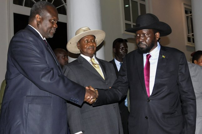 The United States has imposed sanctions on two top Sudanese officials accusing them of impeding the peace process that began when South Sudan President Salva Kiir (R) and the rebel leader Riek Machar (L) signed a peace agreement in September 2018 to form a unity government to end the years of civil war. Photo by EPA-EFE