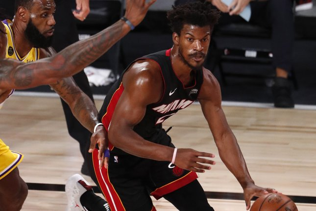 Miami Heat forward Jimmy Butler (R) sustained an ankle injury in the second quarter in Game 1 of the NBA Finals on Wednesday in Orlando, Fla. Photo by Erik S. Lesser/EPA-EFE