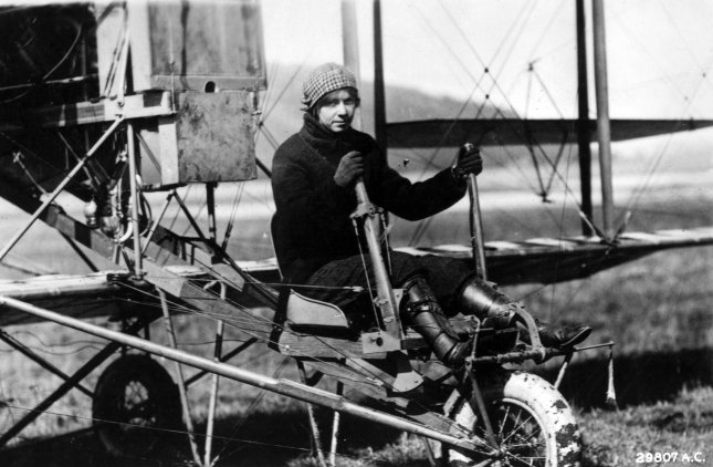 Aviator Ruth Law, ca. 1915, at the controls of Curtiss Pusher, with Wright Brothers produced control levers. Ms. Law became the first enlisted Army aviatrix on June 30, 1917, enjoying one of the longest and most colorful careers of early female aviators. File Photo courtesy Lt. H.M. Benner Hommondsport/USAF