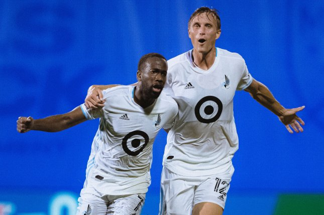 Minnesota United forward Kevin Molino (L) scored two of his team's three goals in a win over Sporting KC on Thursday in Kansas City, Kan. Photo courtesy of Minnesota United