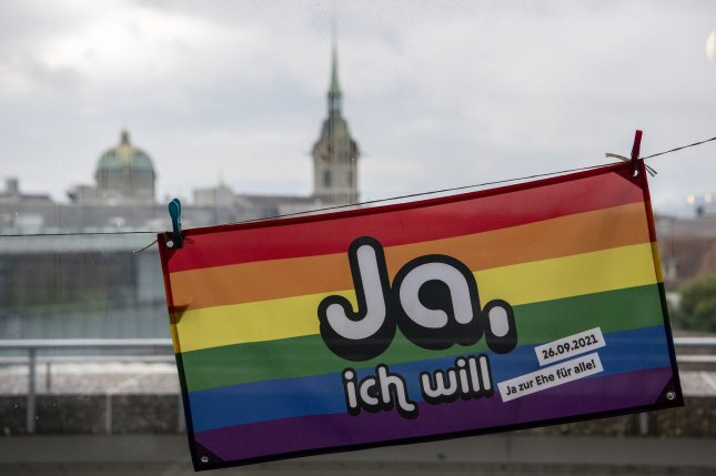 A rainbow-colored flag reading Yes, I will and calling for marriage for all hangs in Bern, Switzerland, on Sunday as the Swiss electorate voted in approval of same-sex marriage. Photo by Peter Schneider/EPA-EFE