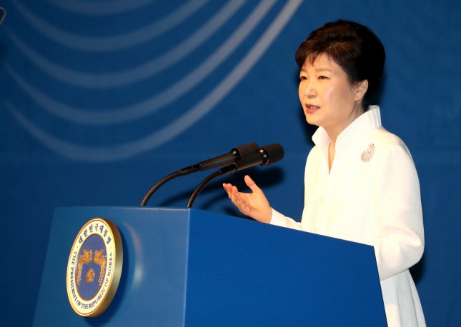 The Seoul offices of Samsung Electronics Corp. were raided Tuesday by prosecutors seeking information about a government scandal rocking the government of President Park Geun-hye, pictured. File Photo by Yonhap News Agency/UPI