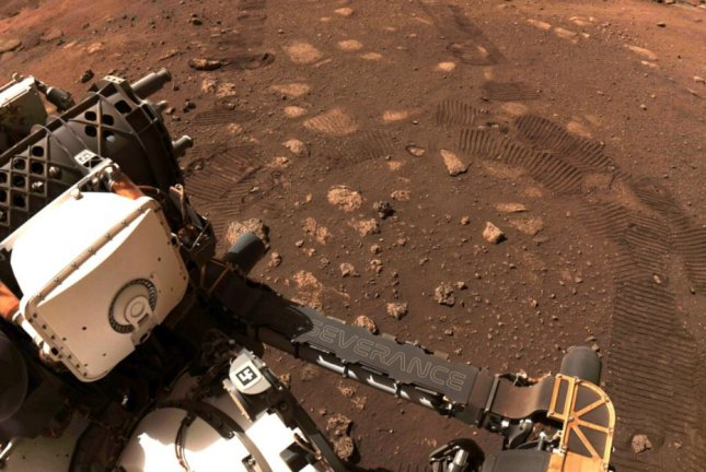 NASA's Mars rover Perseverance is shown on the surface of the planet after making its first drive March 4, the start of its mission to hunt for signs of life on the Red Planet. Photo courtesy of NASA