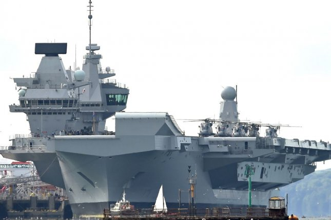 The defense secretaries of Britain and Japan committed to additional defense and security cooperation on Wednesday, partially indicated by the upcoming visit of the carrier strike group led by the HMS Queen Elizabeth, pictured. Photo by Gerry Penny/EPA-EFE