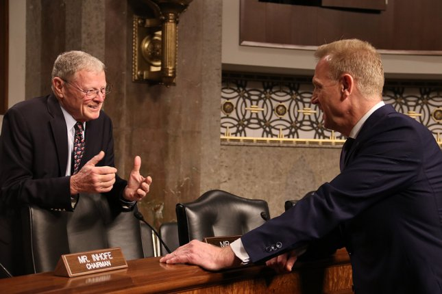 Sen. Jim Inhofe, R.-Okla., chairman of the Senate Armed Services Committee, speaks with acting Secretary of Defense Patrick Shanahan at the committee's hearing on Thursday. Photo by Patty Nieberg/Medill News Service/UPI