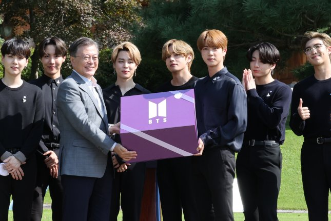 President Moon Jae-in (3-L) meets with members of South Korean boy band BTS on Saturday. Moon said Seoul is to invest nearly $300 million in the country's digital contents industry. File Photo by Yonhap/EPA-EFE
