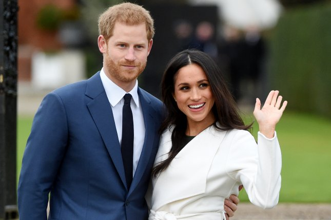 Britain's Prince Harry poses with Meghan Markle during a photocall after announcing their engagement in November. Kensington Palace released part of the couple's wedding guest list on Tuesday. File photo by EPA-EFE/Facundo Arrizabalaga