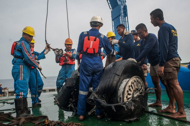 Crew lift the recovered wheel carriage of Lion Air Flight 610 onto a vessel in the waters off Karawang, West Java, Indonesia, on November 4, 2018. File Photo by Fauzy Chaniago/EPA-EFE