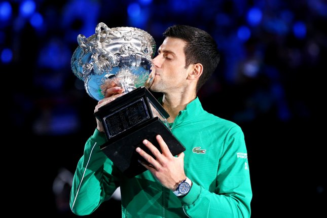 Novak Djokovic of Serbia kisses the Norman Brookes Challenge Cup trophy after winning the men's singles final Sunday against Dominic Thiem of Austria at the Australian Open at Rod Laver Arena in Melbourne, Australia. Photo by Rob Prezioso/EPA-EFE