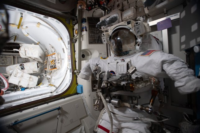 A U.S. spacesuit is pictured in the Quest airlock during a break in spacewalk preparations on the International Space Station on Sunday. Photo courtesy of NASA