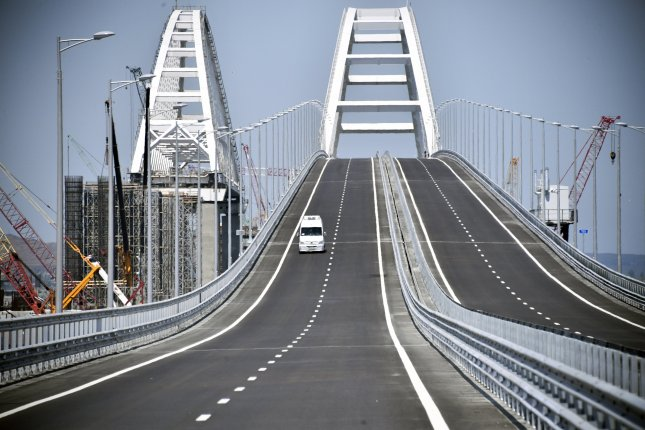 A car drives on the Crimean Bridge over the Kerch Strait on May, 15, 2018, prior to its opening ceremony. The 19-kilometers-long road-and-rail bridge connects the Crimean Peninsula, annexed by Russia from Ukraine in March 2014, with the Taman Peninsula of the Russian mainland. Photo by Alexander Nemenov/EPA-EFE