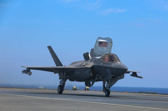 A U.S. Marine with VMFA-211 prepares to launch an F-35B Lightning II from the flight deck of HMS Queen Elizabeth in Sixth Fleet area on Friday. Photo by 1st. Lt. Zachary Bodner/3rd Marine Aircraft Wing/U.S. Marine Corps