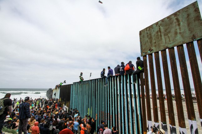 About 70 members of a so-called caravan of migrants from Central America crossed from Mexico to the United States to claim asylum Thursday. Photo by Joebeth Terriquez/EPA