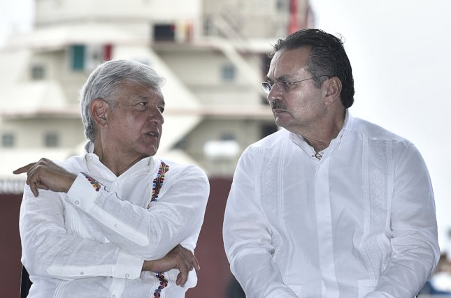 Mexican President Andres Manuel Lopez Obrador (L) and Pemex Director Octavio Romero on Sunday announced plans to help recover the state oil company industry from the disaster they found. Photo courtesy of Pemex