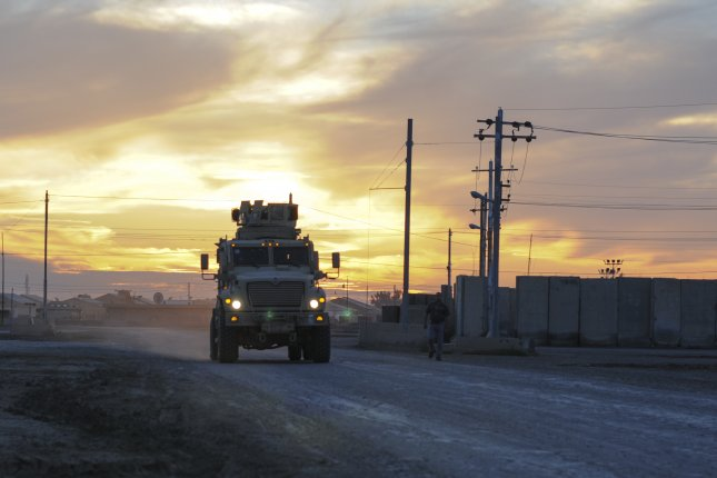 A U.S. Army vehicle is seen on a road in Taji, Iraq. Officials said insurgents attacked a coalition convoy in Taji on Tuesday. File Photo by Staff Sgt. Victor Joecks/U.S. Army National Guard/UPI