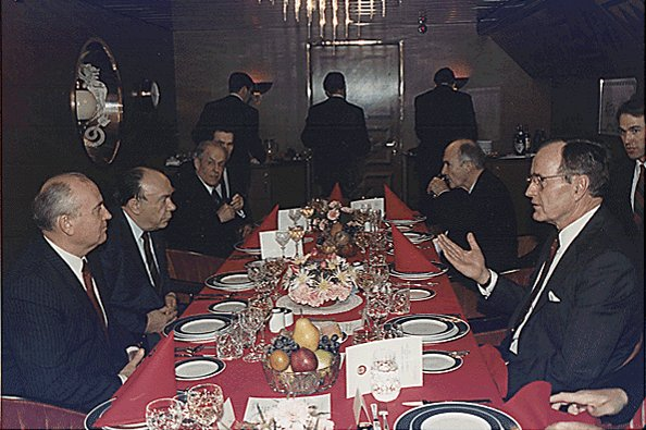 Soviet leader Mikhail Gorbachev (L) and U.S. President George H.W. Bush (R) eat dinner during a summit December 2, 1989, in Malta. On December 3, the two leaders declared an end to the Cold War. File Photo by David Valdez/U.S. president's office