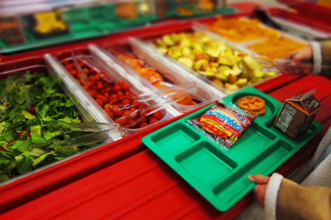 Changes to school lunches in the 2012-2013 school year translated to an estimated 500,000 fewer obese poor American children, researchers report. Photo by Tim Lauer/USDA/Wikimedia