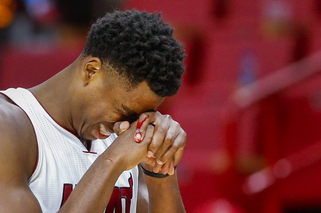 Miami Heat center Hassan Whiteside reacts after injuring his finger during the second half against the Phoenix Suns Tuesday, March 21, 2017 at AmericanAirlines Arena in Miami, Florida. The Heat defeated the Suns. EPA/ERIK S. LESSER