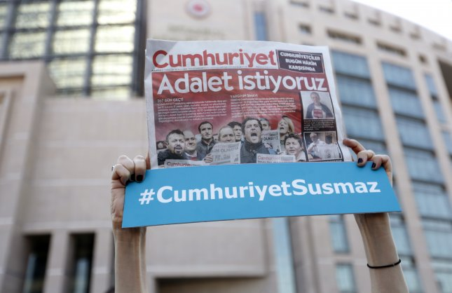 A Turkish court sentenced 14 journalists from the Cumhuriyet newspaper to prison on charges that they worked to support groups the government considers terrorist organizations. Photo by Erdem Sahin/EPA