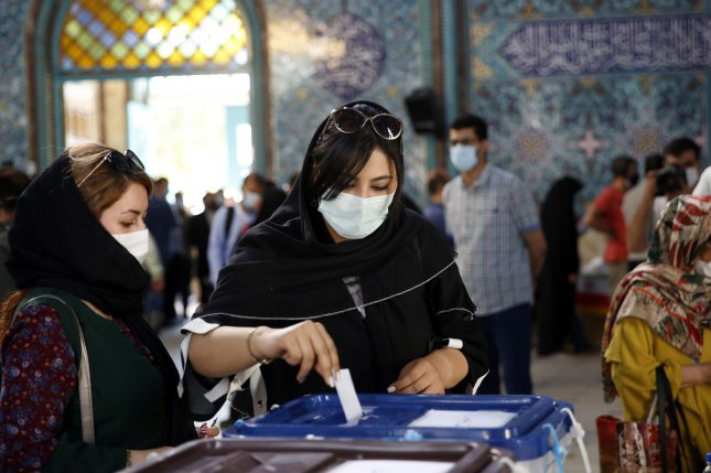 Iranian women cast their votes at a polling station during the presidential election in Tehran on Friday. Photo by Abedin Taherkenareh/EPA-EFE