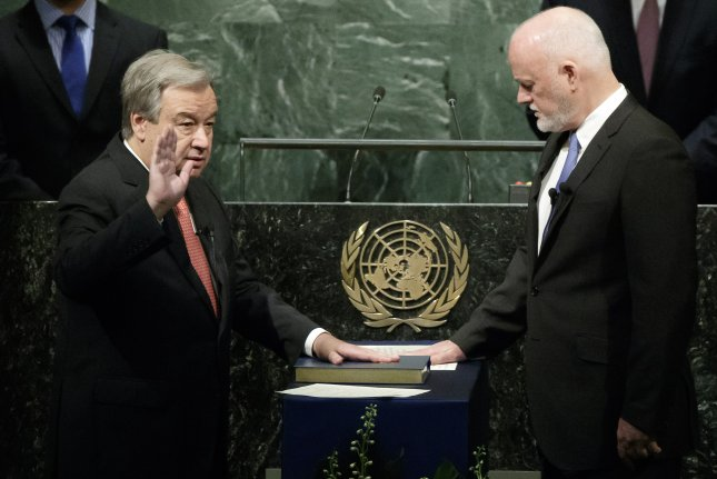 Secretary-General designate Antonio Guterres (L) is sworn in by Peter Thomson, president of the 71st session of the General Assembly, during a ceremony at United Nations headquarters in New York City on Monday. Guterres will officially take over the position from Ban Ki-moon on Jan. 1. Photo by Justin Lane/European Pressphoto Agency