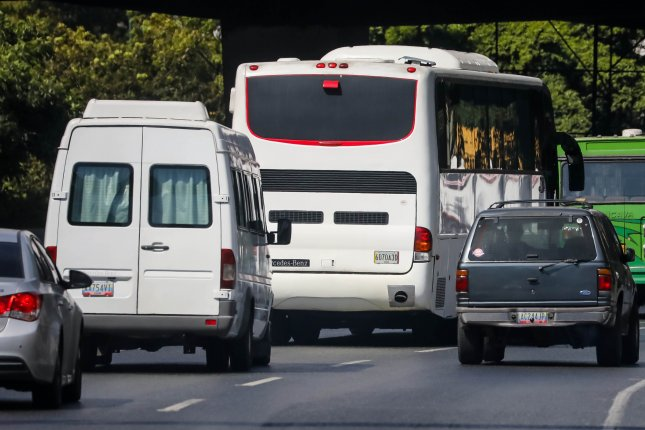 Buses carry National Assembly deputies on the Francisco Fajardo highway in Caracas, Venezuela on Thursday as they head to the Tachira state at the border with Colombia where the humanitarian aid remains. Photo by Miguel Gutierrez/EPA-EFE