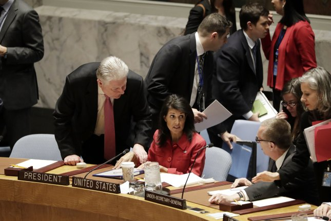 U.S. Ambassador to the United Nations and Security Council President Nikki Haley (C) talks to members of the United Nations Security Council before an emergency meeting Friday to discuss the situation in Syria at U.N. headquarters in New York City. Photo by Jason Szenes/EPA