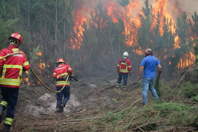 Firefighters combat a forest fire in Gaeiras, Marinha Grande, Portugal, on Monday. Photo by Tiago Petinga/EPA-EFE