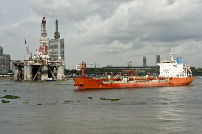 A tanker and oil rig in Lagos, Nigeria, a country exempt from OPEC's efforts to balance the markets. Coupled with Libya, it could derail OPEC's goals. Photo by vanhurck/Shutterstock