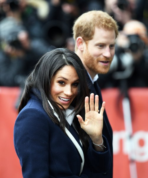 Prince Harry (R) and Meghan Markle mailed out gilded wedding invitations to guests this week. File Photo by Andy Rain/EPA-EFE