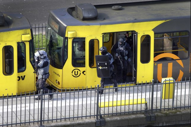 Police inspect a tram Monday after a shooting attack in Utrecht, The Netherlands, Photo by Ricardo Smit/EPA-EFE